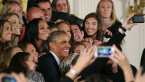 Barack Obama poses for a selfie with members of the World Champion United States Womens National Soccer Team
