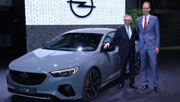Michael Lohscheller (R), CEO of German carmaker Opel, and Carlos Tavares, Chairman of PSA Peugeot Citroen, stand next to a 2017 Opel Insignia GSi at the 2017 Frankfurt Auto Show