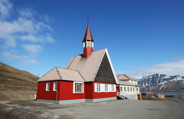 The worlss Northernmost church stands overlooking the town of Longyearbyen during Midsummer on June 21, 2008 in Longyearbyen, Norway